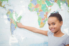 Student pointing to a map of the world Stock Photos