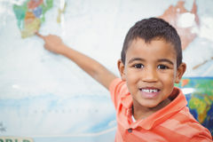 Student pointing to a map of the world Stock Image