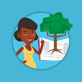 Student pointing at tree of knowledge. Royalty Free Stock Photography