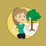 Student pointing at tree of knowledge. Stock Photo