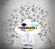A student is pondering over the graduation process in the university. Royalty Free Stock Photos