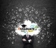 A student is pondering over the graduation process in the university. Stock Photos