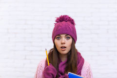 Student Pondering Worried Attractive Girl In Pink Hat Holding Folder Pencil Stock Image