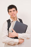 Student portrait. Portrait of smiling young student with his working bag and laptop Stock Image