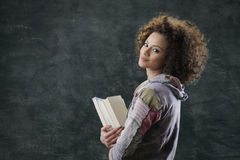 Student. Portrait of beautiful girl student with books Royalty Free Stock Photography