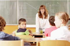 Student portrait in the classroom Royalty Free Stock Photos