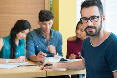 Student portrait. Closeup shot of young men looking at camera. Male student preparing university exam. Shallow depth of field with focus on handsome young men Royalty Free Stock Images