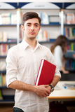 Student portrait in a library Royalty Free Stock Photography