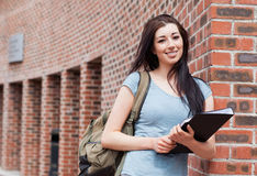 Student posing with a binder. Outside a building Royalty Free Stock Photography