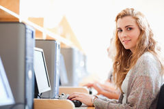 Student posing with a computer Royalty Free Stock Photography