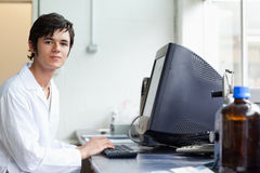 Student posing with a monitor Royalty Free Stock Images