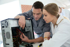 Student practicing reparations of hard disc Stock Photo