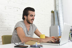 Student preparing exam relaxed or informal hipster style businessman working with laptop computer Royalty Free Stock Photos