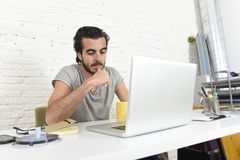Student preparing exam thinking or informal hipster style businessman working with laptop computer Royalty Free Stock Images