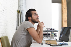 Student preparing exam thinking or informal hipster style businessman working with laptop computer Stock Photo