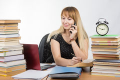 Student preparing for exams and talking on the phone Royalty Free Stock Photos
