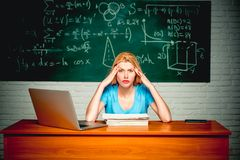 Student preparing for university exams. Student girl reading a presentation on laptop. Knowledge. Knowledge day. Bad. Exam. Emotional young face. Portrait of stock photos