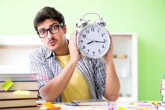 The student preparing for university exams with many conflicting priorities in time management concept. Student preparing for university exams with many royalty free stock photography