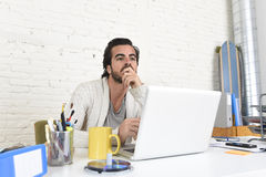 Student preparing university project or hipster style freelancer businessman working with laptop Royalty Free Stock Images
