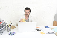 Student preparing university project or hipster style freelancer businessman working with laptop. Young happy attractive student preparing university project Stock Photo