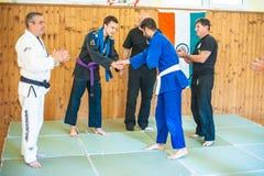 Student is promoted and gets BJJ Brazilian Jiu-Jitsu Purple Belt royalty free stock photography