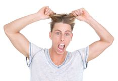 Student pulling his hair out in frustration Royalty Free Stock Images