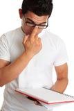 Student pushing up glasses onto face Royalty Free Stock Image