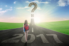 Student with 2017 and question mark on street Royalty Free Stock Image