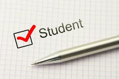 Student questionnaire choice. Educational survey. Occupation concept. Marked checkbox with a silver pen on paper. Student questionnaire choice. Marked checkbox Royalty Free Stock Photo