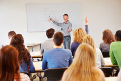 Student raising hand in school Stock Photo