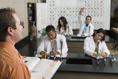 Student Raising Hand In Science Class Stock Photography