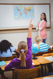 Student raising hand to ask a question. At the elementary school Royalty Free Stock Photography