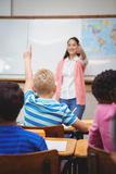 Student raising hand to ask a question. At the elementary school Royalty Free Stock Images