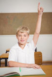 Student raising hand to ask question. At the elementary school Stock Images