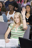 Student Raising Her Hand To Answer Stock Image