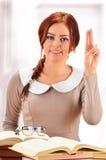 Student raising her hand in university class Stock Photos