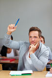 Student raising his hand Stock Photo