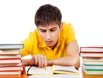 Student read the Book. Student read a Book on the School Desk on the White Background stock image
