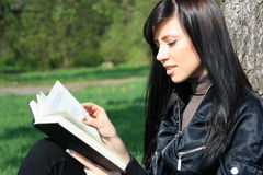 Student reading book. Cheerful young woman reading book Royalty Free Stock Images