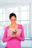 Student reading a book Stock Photo