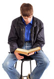 Student reading book Stock Image