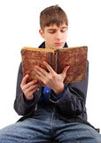 Student reading book. Teenager reads old book isolated on the white background Royalty Free Stock Image
