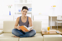 Student reading book Stock Images