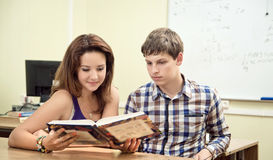 Student reading a book in the classroom Royalty Free Stock Photography