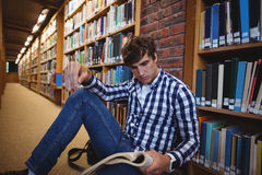 Student reading book in college library Stock Photo