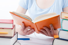 Student reading a book Stock Images