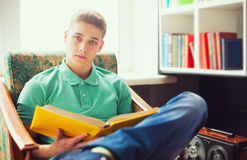 Student reading book at home Royalty Free Stock Image
