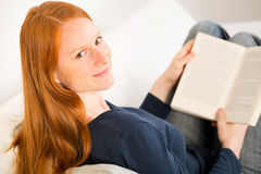 Student Reading a Book at Home Royalty Free Stock Photography