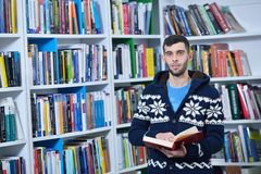Student reading book in library Study lessons for exam.  Stock Images