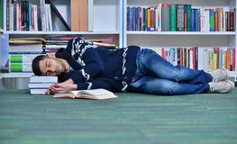 Student reading book in library Study lessons for exam.  Royalty Free Stock Photos